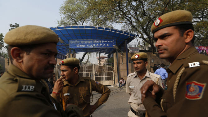 Indian police men stand outside the Tihar Jail, the largest complex of prisons in South Asia, in New Delhi, India, Monday, March 11, 2013. Indian police confirmed that Ram Singh, one of the men on trial for his alleged involvement in the gang rape and fatal beating of a woman aboard a New Delhi bus committed suicide at the Tihar jail Monday, but his lawyer and family allege he was killed. (AP Photo/Saurabh Das)