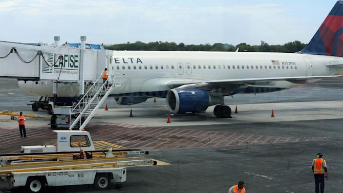 A Delta airliner is parked on the tarmac after making an emergency landing at the Augusto C. Sandino International Airport in Managua