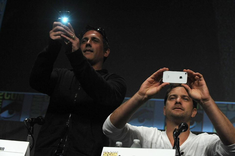 "J.H. Wyman and Joshua Jackson take pictures at the ""Fringe"" screening and panel at Comic-Con on Sunday, July 15, 2012 in San Diego. (Photo by Jordan Strauss/Invision/AP)"