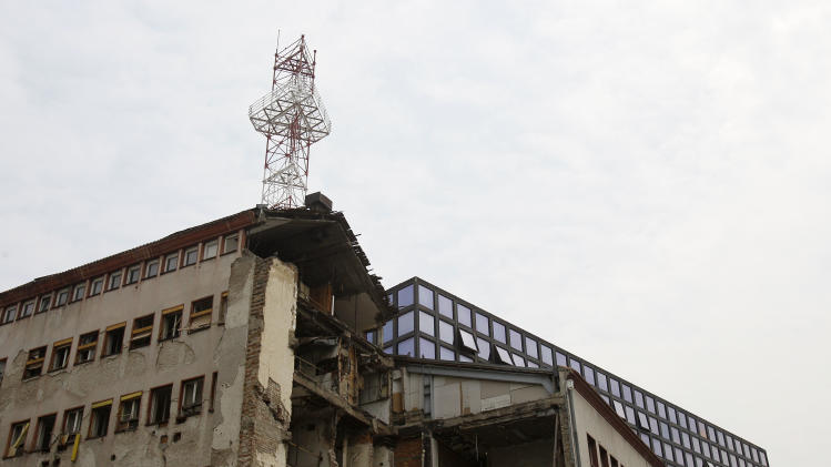 "The Serbian state television building destroyed during NATO's bombing campaign which led to the deaths of 16 workers in an alliance missile attack on April 1999, seen in front of the new building, in downtown Belgrade, Serbia, Tuesday, May 24, 2011. Serbia's state-run television has apologized to viewers at home and in the other countries of the former Yugoslavia for the war propaganda and hate speech during the era of late autocrat Slobodan Milosevic. The Radio Television of Serbia says in a statement posted on its web site Tuesday that the station's program was ""almost constantly and heavily abused"" as a propaganda tool of Milosevic's regime during the 1990s'. (AP Photo/Darko Vojinovic)"