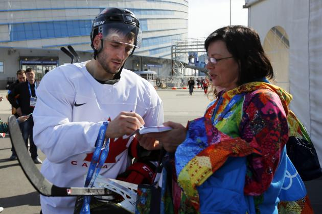 Canada's ice hockey player patrice bergeron signs an autograph
