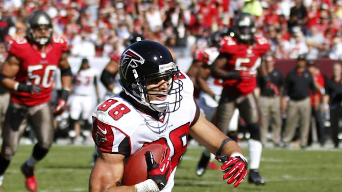 Atlanta Falcons tight end Tony Gonzalez (88) knocks down Tampa Bay Buccaneers free safety Ronde Barber (20) after a reception during the second quarter of an NFL football game on Sunday, Nov. 25, 2012, in Tampa, Fla. (AP Photo/Reinhold Matay)