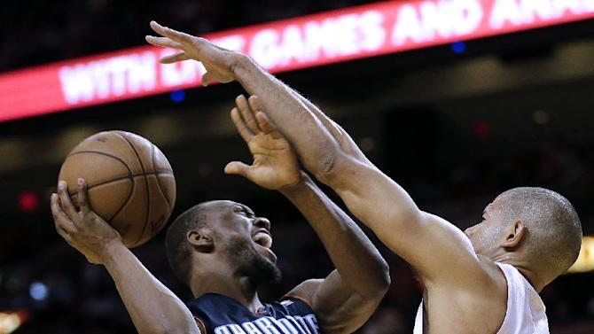 Miami Heat's Shane Battier (31) attempts to block Charlotte Bobcats' Kemba Walker (15) during the second half of an NBA basketball game in Miami, Sunday, March 24, 2013. The Heat won 109-77.  (AP Photo/J Pat Carter)