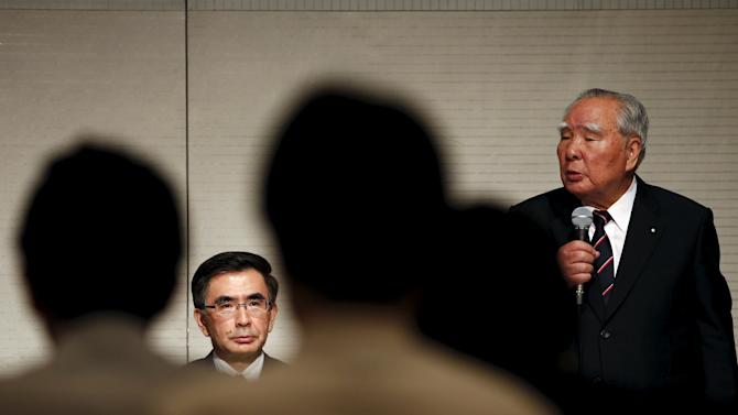 Suzuki Motor CEO Suzuki speaks during presentation as his son Suzuki listens in Tokyo