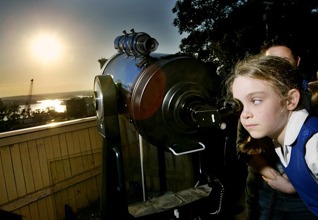 FILE - In this June 8, 2004 file photo, amateur astronomer Jody McGowen looks through a telescope to watch the transit of Venus from Sydney's Observatory Hill. Venus will again cross the face of the sun on Tuesday June 5, 2012, a sight that will be visible from parts of Earth. This is the last transit for more than 100 years. (AP Photo/Mark Baker, File)