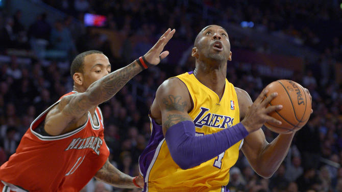 Los Angeles Lakers guard Kobe Bryant, right, goes up for a shot as Milwaukee Bucks guard Monta Ellis defends during the first half of an NBA basketball game, Tuesday, Jan. 15, 2013, in Los Angeles. (AP Photo/Mark J. Terrill)
