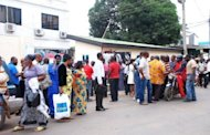 Supporters of Ghana's Ruling National Democratic Congress gather outside the ruling party headquarters in Accra. Ghana was plunged into mourning after the sudden death of president John Atta Mills five months ahead of elections in the country seen as a bastion of democracy in west Africa