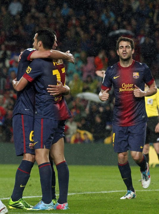 Barcelona's Hernandez, Rodriguez and Fabregas celebrate a goal against Real Valladolid during their Spanish First division soccer league match in Barcelona