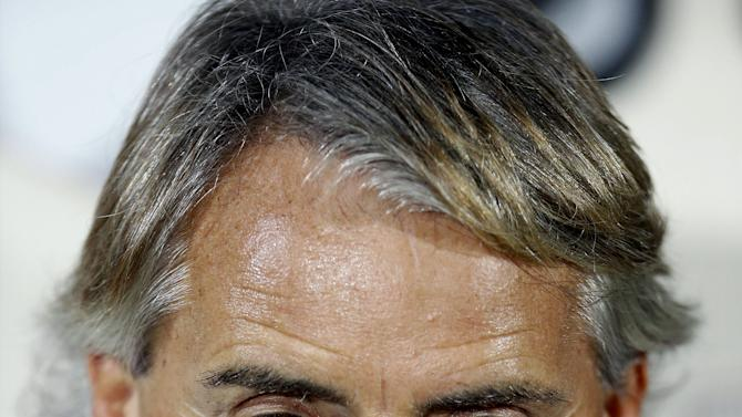 Inter Milan's coach Mancini looks on before their Serie A soccer match against Carpi in Modena