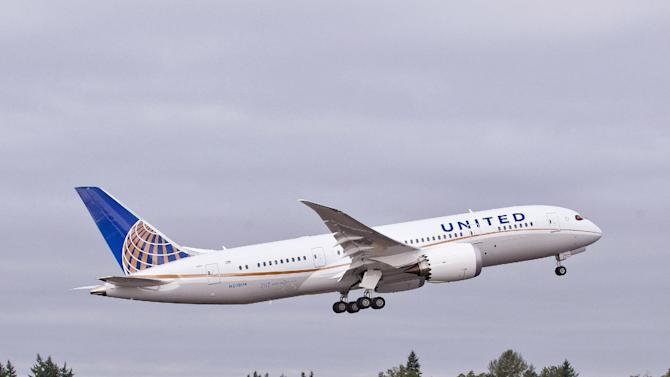 In this undated photo provided by Boeing Commercial Airplanes, the first Boeing 787 that will be used by United Airlines, is shown taking off.  U.S. travelers are going to be seeing a lot more of the 787, the ultra-lightweight jet that aims to reduce flier fatigue and airline fuel bills. United announced the week ofThursday, Sept. 27, 2012, that it has become the first U.S. airline to get the newest Boeing plane, and flights from Houston to Chicago will begin November 4. The carrier joins All Nippon Airlines and Japan Airlines, who have started 787 service from U.S. cities, or will soon. (AP Photo/Boeing, Matthew Thompson)