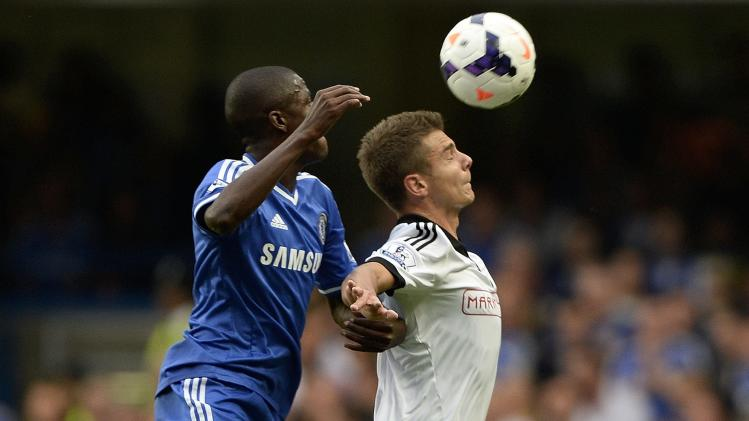 Chelsea's Ramires challenges Fulham's Kacaniklic during during their English Premier League soccer match in London