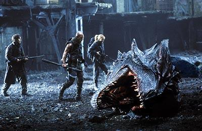 Quinn ( Christian Bale ), Van Zan ( Matthew McConaughey ) and Alex ( Izabella Scorupco ) come upon a dragon head in Touchstone's Reign of Fire