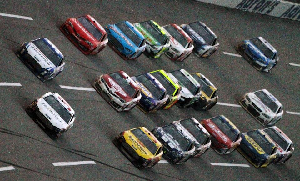 David Ragan, front, leads a pack of cars on the final lap to win the NASCAR Sprint Cup Series Aaron's 499 auto race at Talladega Superspeedway in Talladega, Ala., Sunday, May 5, 2013. (AP Photo/Jay Alley)