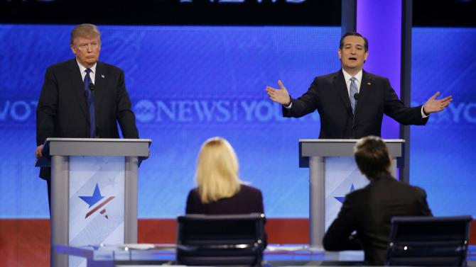 Republican U.S. presidential candidate Trump listens as Cruz speaks during the Republican U.S. presidential candidates debate sponsored by ABC News at Saint Anselm College in Manchester
