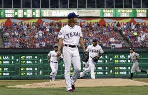 Darvish wins ML debut in Rangers' 11-5 win over Ms