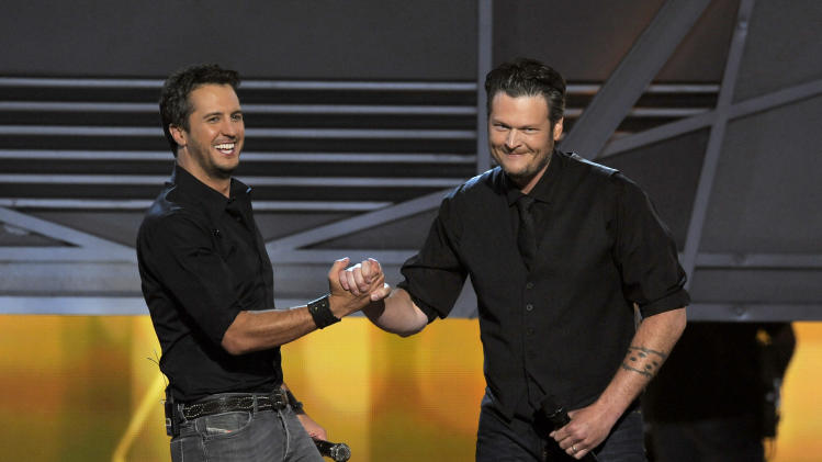 Luke Bryan, left, and Blake Shelton speak on stage at the 48th Annual Academy of Country Music Awards at the MGM Grand Garden Arena in Las Vegas on Sunday, April 7, 2013. (Photo by Chris Pizzello/Invision/AP)
