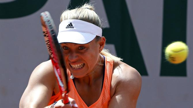 Angelique Kerber of Germany plays a shot to Timea Babos of Hungary during their women's singles match at the French Open tennis tournament at the Roland Garros stadium in Paris