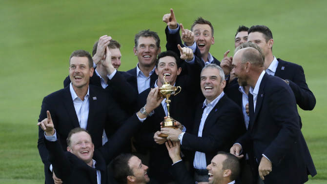 Europe team captain Paul McGinley, center right, and his team  hold the trophy after winning the 2014 Ryder Cup golf tournament at Gleneagles, Scotland, Sunday, Sept. 28, 2014. (AP Photo/Matt Dunham)