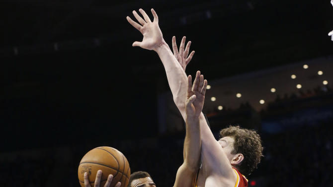 Oklahoma City Thunder guard Thabo Sefolosha (2)  is fouled by Houston Rockets center Omer Asik (3) as he shoots in the fourth quarter of Game 5 of their first-round NBA basketball playoff series in Oklahoma City, Wednesday, May 1, 2013. Houston won 107-100. (AP Photo/Sue Ogrocki)