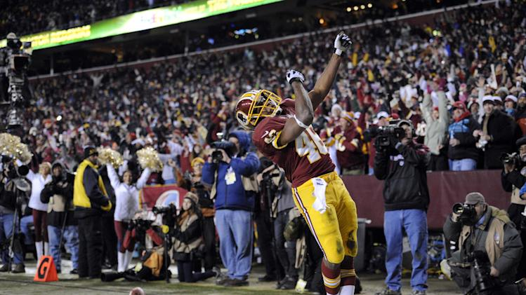 Washington Redskins running back Alfred Morris (46) celebrates his touchdown during the first half of an NFL football game against the Dallas Cowboys, Sunday, Dec. 30, 2012, in Landover, Md. (AP Photo/Nick Wass)
