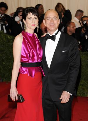 FILE - In a Monday, May 7, 2012 file photo, Amazon founder, president and CEO Jeff Bezos and wife Mackenzie Bezos arrive at the Metropolitan Museum of Art Costume Institute gala benefit, celebrating Elsa Schiaparelli and Miuccia Prada, in New York. Bezos and his wife MacKenzie announced a gift Friday, July 27, 2012 of $2.5 million to the campaign to defend Washington's same-sex marriage law.   (AP Photo/Evan Agostini, File)