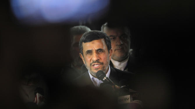 Iran's President Mahmoud Ahmadinejad, center, talks during a presser following his meeting with Grand Sheik Ahmed al-Tayeb, the head of Al-Azhar, the Sunni Muslim world's premier Islamic institution, not pictured, at Al Azhar headquarters in Cairo, Egypt, Tuesday, Feb. 5, 2013. Egypt's most prominent Muslim cleric, the sheik of Al-Azhar, has warned Iranian President Mahmoud Ahmadinejad against interfering in Arab Gulf countries or trying to spread Shiite influence. Ahmadinejad, on a landmark visit to Egypt on Tuesday, received an uneasy reception from Ahmed el-Tayeb at Al-Azhar, the Sunni Muslim world's foremost Islamic institution.(AP Photo/Amr Nabil)