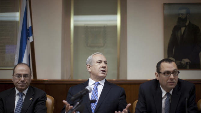 Israeli Prime Minister Benjamin Netanyahu heads the weekly cabinet meeting in his office in Jerusalem, Sunday, Feb. 10, 2013. Netanyahu said Sunday the upcoming visit of U.S. President Barack Obama will focus on Iran's nuclear program, the violence in Syria and the stalled peace process with the Palestinians. (AP Photo/Uriel Sinai, Pool)