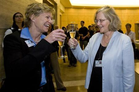 Australian-born Elizabeth Blackburn has a champagne toast with Susan Desmond-Hellmann, Chancellor of the University of California, San Francisco, in San Francisco