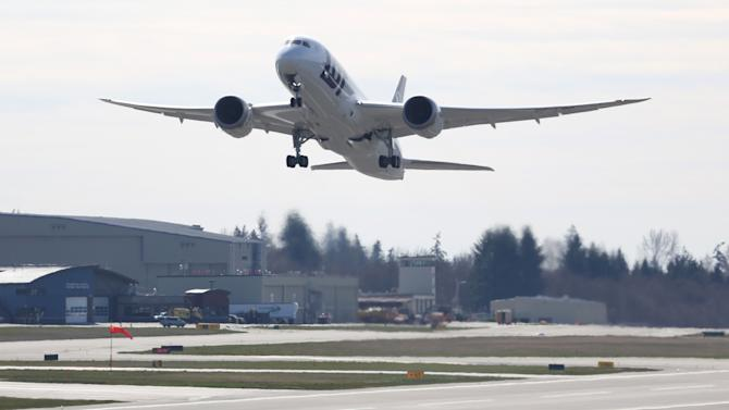 A Boeing 787 lifts off on Monday, March 25, 2013 at Paine Field in Everett. This was the first test flight of a 787 since the fleet was grounded because the danger of a fire with the lithium-Ion battery in the plane. (AP Photo/seattlepi.com, Joshua Trujillo)