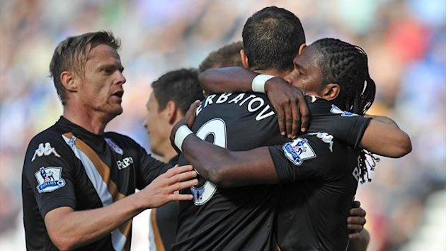 Fulham's Hugo Rodallega (right) is congratulated by Dimitar Berbatov (centre) on scoring his team's first goal Premier League - Wigan Athletic v Fulham - DW Stadium