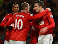 Manchester United&#39;s Wayne Rooney (centre) and Robin van Persie (right) at a Premier League match at Old Trafford on December 15, 2012. Alex Ferguson believes his team&#39;s trip to Swansea City is the start of a pivotal run of matches which will bring them closer to winning a 20th league title