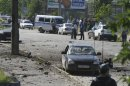 Police and investigators work at the site of a car blast in Makhachkala
