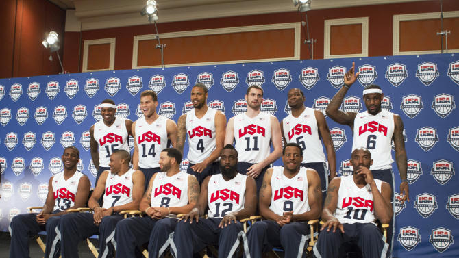 The twelve players selected for the 2012 U.S. Olympic men's basketball team pose during a news conference at the Wynn Las Vegas Resort in Las Vegas
