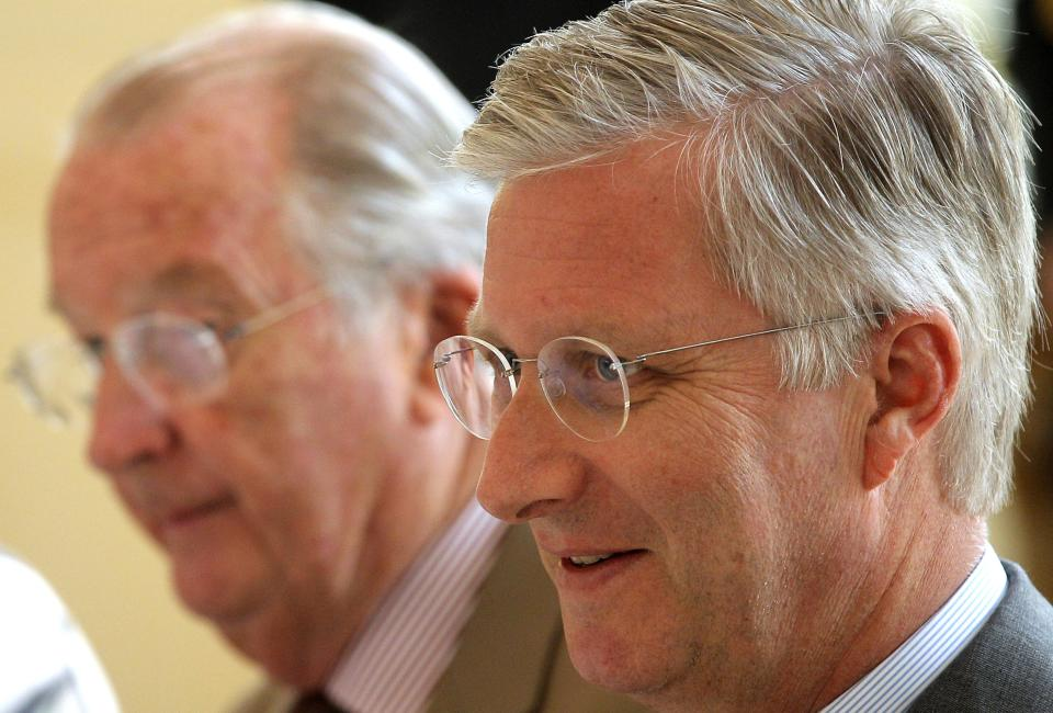 Crown Prince Philippe, right, and Belgian King Albert II attend a farewell lunch with the Belgian federal government at the Royal Palace in Laeken near Brussels, Monday, July 15, 2013. Belgian King Albert will abdicate in favor of Crown Prince Philippe on July 21. (AP Photo/Yves Logghe)