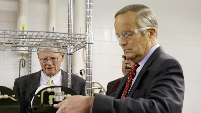 Missouri Senate candidate, Rep. Todd Akin, R-Mo., picks up a portable medical oxygen pack as he tours Essex Industries, a supplier to the aerospace and defense industries, along with Sen. James Inhofe, R-Okla., left, Monday, Oct. 29, 2012, in St. Louis County, Mo. Akin is running for Senate against Democratic incumbent Sen. Claire McCaskill. (AP Photo/Jeff Roberson)