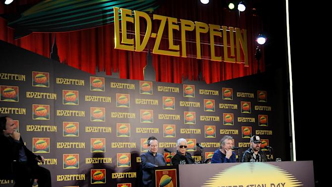 """Led Zeppelin, from left, bassist/keyboardist John Paul Jones, guitarist Jimmy Page, singer Robert Plant, and drummer Jason Bonham participate in a press conference ahead of the worldwide theatrical release of """"Celebration Day"""", a concert film of their 2007 London O2 arena reunion show, at the Museum of Modern Art on Tuesday, Oct. 9, 2012 in New York. (Photo by Evan Agostini/Invision/AP)"""