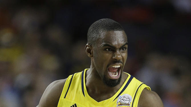 Michigan's Tim Hardaway Jr. (10) reacts to play against Syracuse during the second half of the NCAA Final Four tournament college basketball semifinal game Saturday, April 6, 2013, in Atlanta. (AP Photo/Charlie Neibergall)