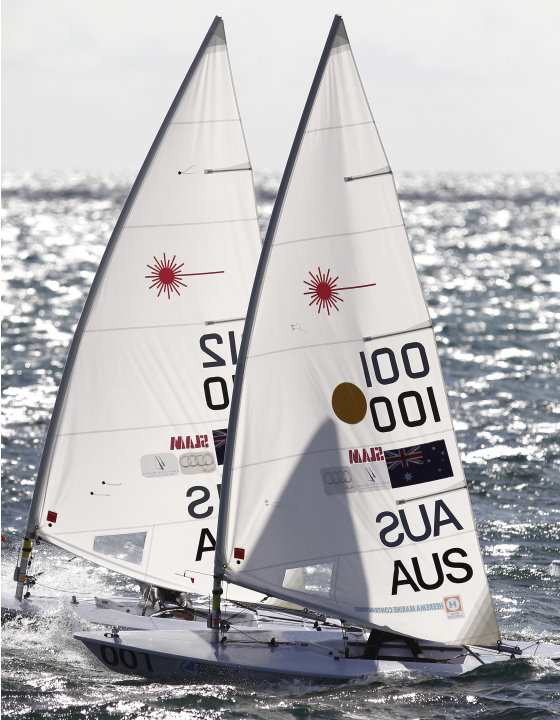 Australia's Tom Slingsby, right, competes on his way to winning the gold medal during the Men's Laser gold medal race at the Sailing Championships in Perth, Australia, Sunday, Dec. 18, 2011. (AP Photo