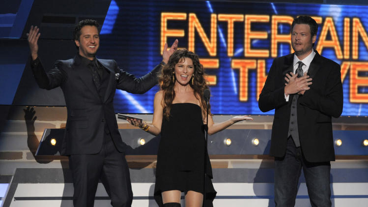 FILE - This April 7, 2013 file photo shows country music singers, from left, Luke Bryan, Shania Twain and Blake Shelton on stage at the 48th Annual Academy of Country Music Awards at the MGM Grand Garden Arena in Las Vegas. The Nielsen company said that the Academy of Country Music Awards on Sunday was seen by an estimated 15.5 million people. That's believed to be the first time the ACM awards had a bigger audience than the more established Country Music Association awards. That show was aired in November. (Photo by Chris Pizzello/Invision/AP, file)