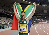 South Africa's Oscar Pistorius poses with a national flag after winning gold in the men's 400m - T44 final during the athletics competition at the London 2012 Paralympic Games. The Paralympic flame will be extinguished in London after the final day of competition at the Games, bringing down the curtain on a summer of elite sport in the British capital