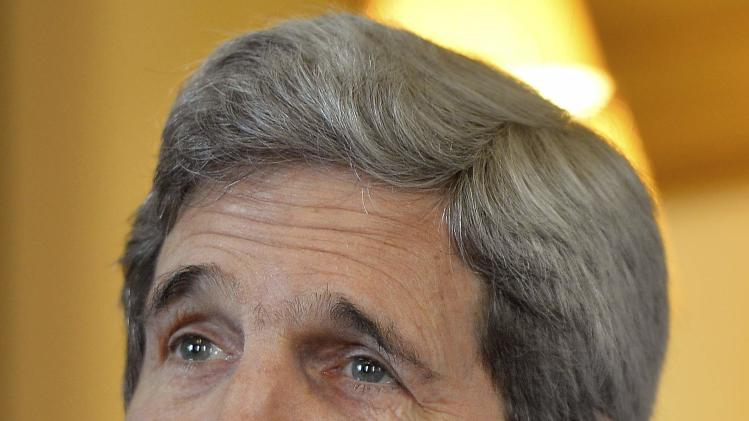 U.S. Secretary of State Kerry attends a meeting with British PM Cameron and Foreign Secretary Hague in central London