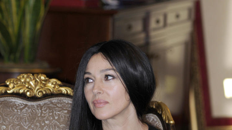 Italian actress Monica Bellucci , during a meeting with the President of the Republic of Srpska Milorad Dodik , during a visit to Bosnian town of Banja Luka, 240 kms northwest of Sarajevo, Bosnia, on Saturday, Jan. 19, 2013. (AP Photo/Radivoje Pavicic )