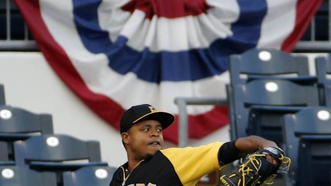 Pittsburgh Pirates starting pitcher Edinson Volquez throws long toss in the outfield during a team workout at PNC Park in Pittsburgh Tuesday, Sept. 30, 2014. Volquez gets the start against the San Francisco Giants in Wednesday's National League baseball Wild Card game in Pittsburgh. (AP Photo/Gene J. Puskar)