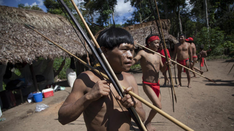 In this photo taken Sept. 7, 2012, Yanomami Indians dance in their village called Irotatheri in Venezuela's Amazon region. A Venezuelan army spokesman, who traveled with other military officers and journalists, said that officials found no sign of any killings and that all was peaceful in the area, which is located 19 kilometers (12 miles) from the border with Brazil, despite a report of a mass killing there. (AP Photo/Ariana Cubillos)