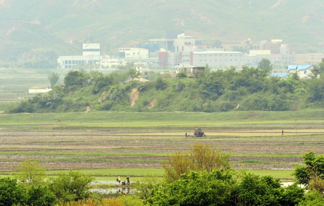 North Koreans work on a field at the propaganda village of Gijungdong in North Korea, in this picture taken near the truce village of Panmunjom, just south of the demilitarized zone dividing the two K