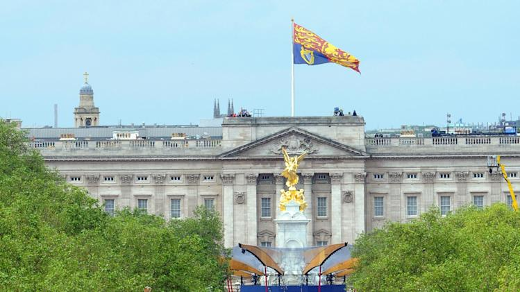 Queen Elizabeth II is driven down the Mall, London, for a service of thanksgiving at St Paul's Cathedral as the Diamond Jubilee celebrations continue. Tuesday June 5, 2012. Buckingham Palace is in the background. (AP Photo/Anthony Devlin/Pool)
