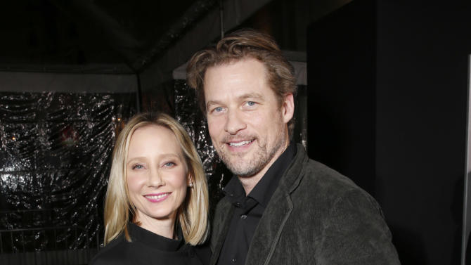 "Anne Heche and James Tupper arrive at the premiere of ""Hansel & Gretel Witch Hunters"" on Thursday Jan. 24, 2013, in Los Angeles.  (Photo by Todd Williamson/Invision/AP)"