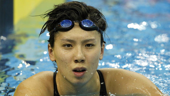 Singapore's Amanda Lim rests after her race in a women's 50m Freestyle heat at the FINA Swimming World Championships in Shanghai, China, Saturday, July 30, 2011.  (AP Photo/Wong Maye-E)