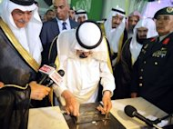 Saudi King Abdullah lays the foundation stone for the development and expansion project of Prophet Mohammed's mosque, one of Islam's three oldest mosques in the world, in the holy city of Medina on September 25, 2012