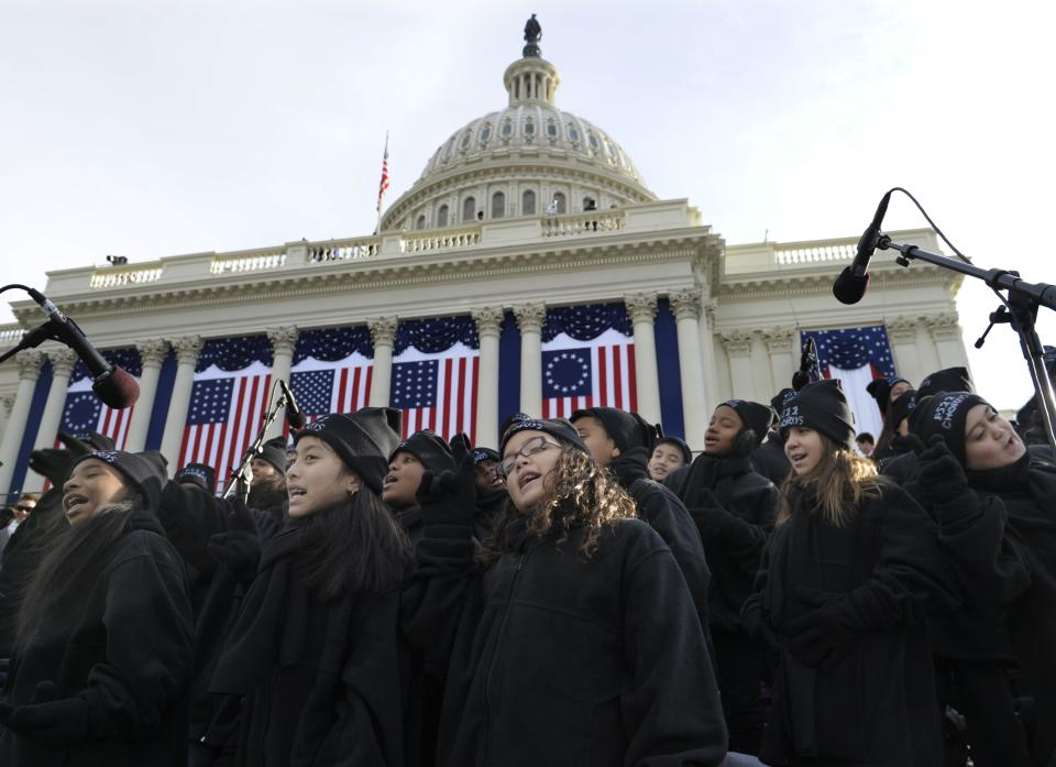 Members of the Lee University Festival Choir and PS 22 Chorus perform before the ceremonial swearing-in of President Barack Obama at the U.S. Capitol during the 57th Presidential Inauguration in Washington, Monday, Jan. 21, 2013. (AP Photo/Susan Walsh)